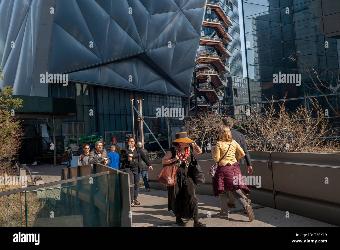 """Tourists on the High Line Park pass """"The Shed"""" arts space in Hudson Yards on Saturday, March 30, 2019 . (© Richard B. Levine) Stock Photo"""
