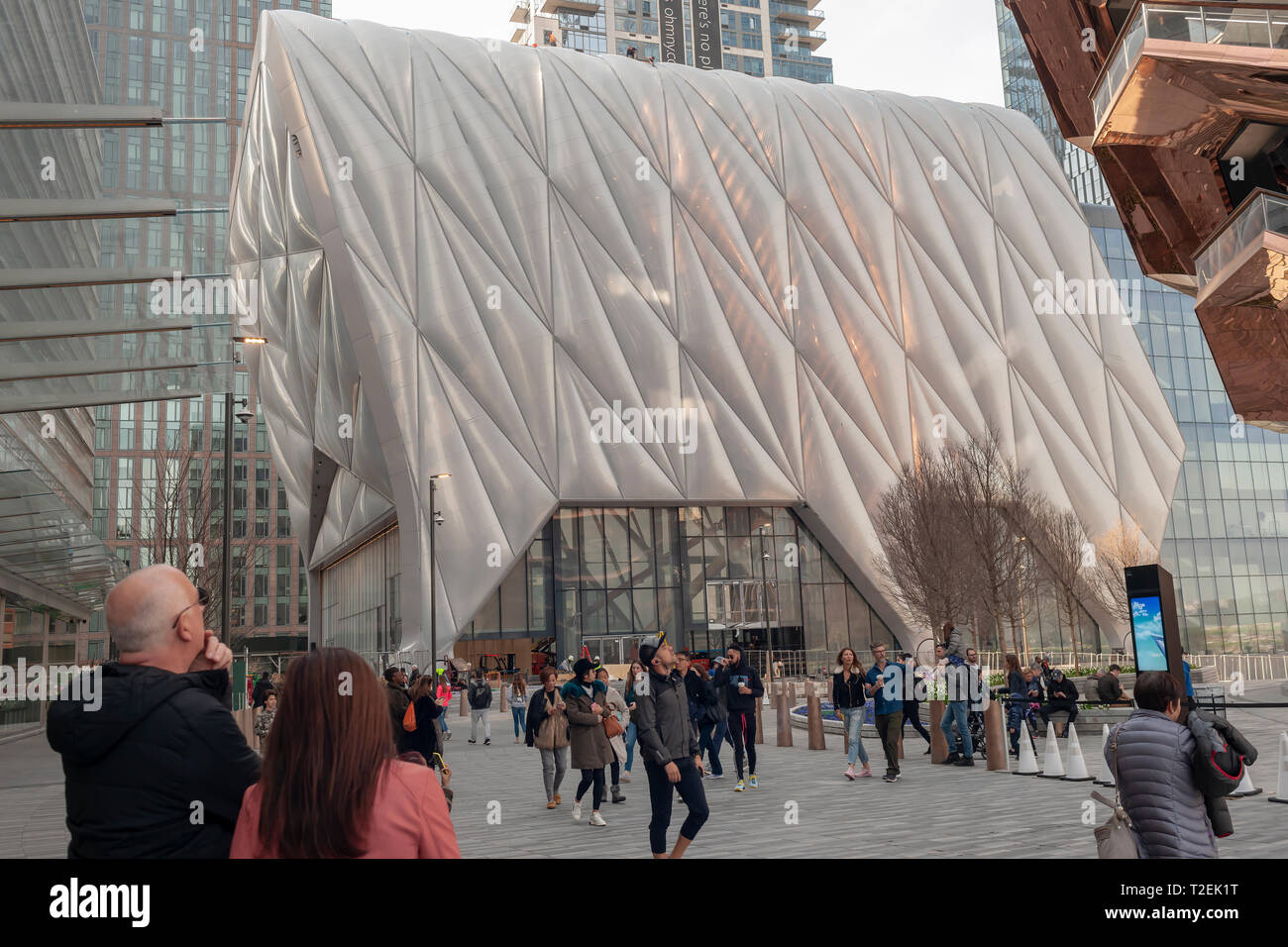 "Tourists in the plaza of Hudson Yards pass ""The Shed"" arts space as workers prepare it for its opening, seen on Saturday, March 30, 2019 . (© Richard B. Levine) Stock Photo"