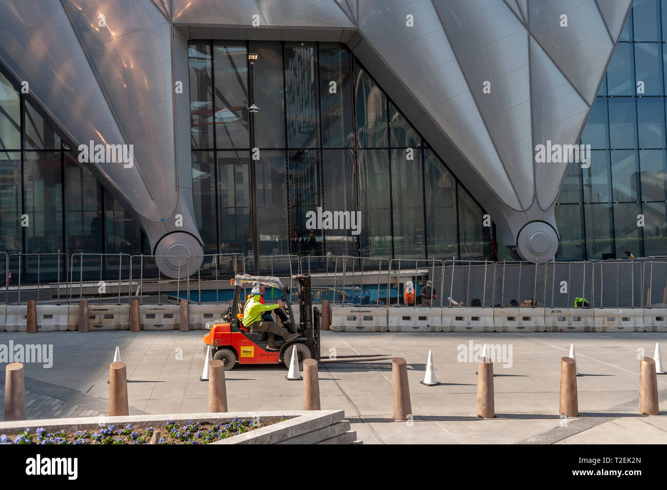 """Workers scurry about preparing """"The Shed"""" arts space in Hudson Yards for its opening, seen on Saturday, March 30, 2019 . (© Richard B. Levine) Stock Photo"""
