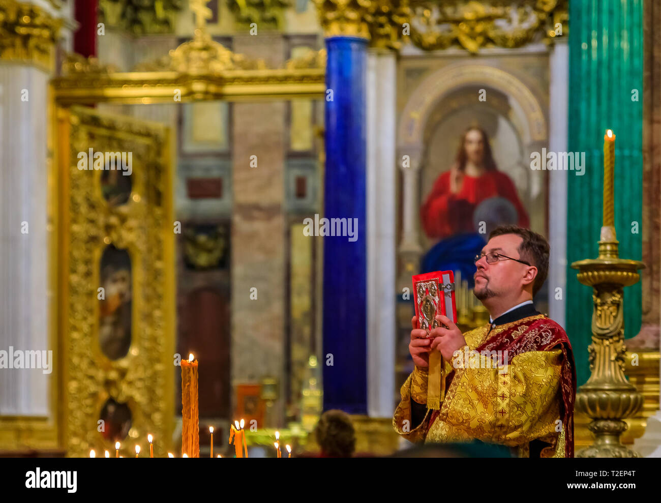 Saint Petersburg, Russia - September 10, 2017: Russian Orthodox priest in traditional clerical clothing serving mass in the Saint Isaac's Russian Orth - Stock Image