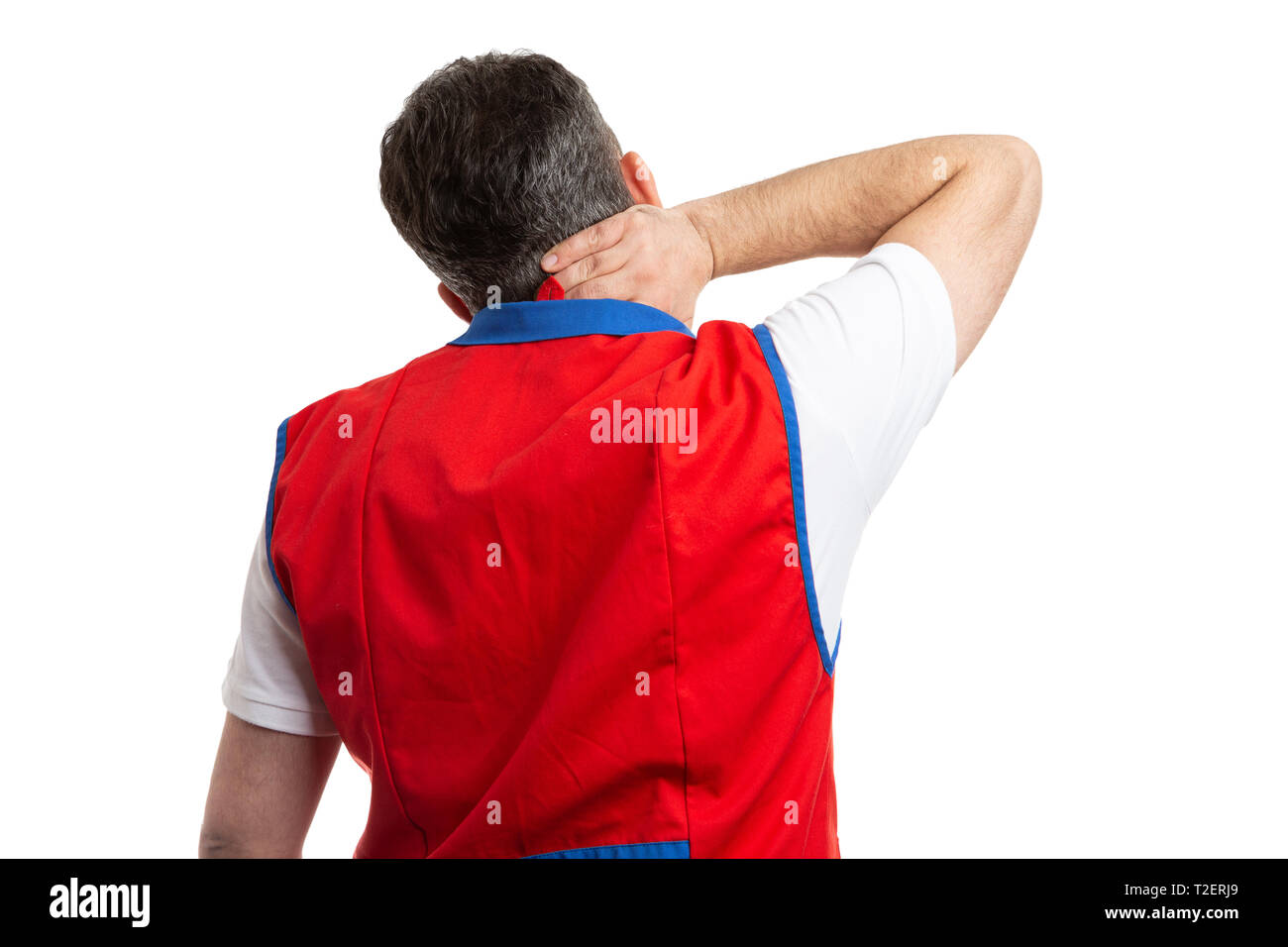 Male supermarket or hypermarket employee holding hand on painful neck with back to camera isolated on white studio background - Stock Image