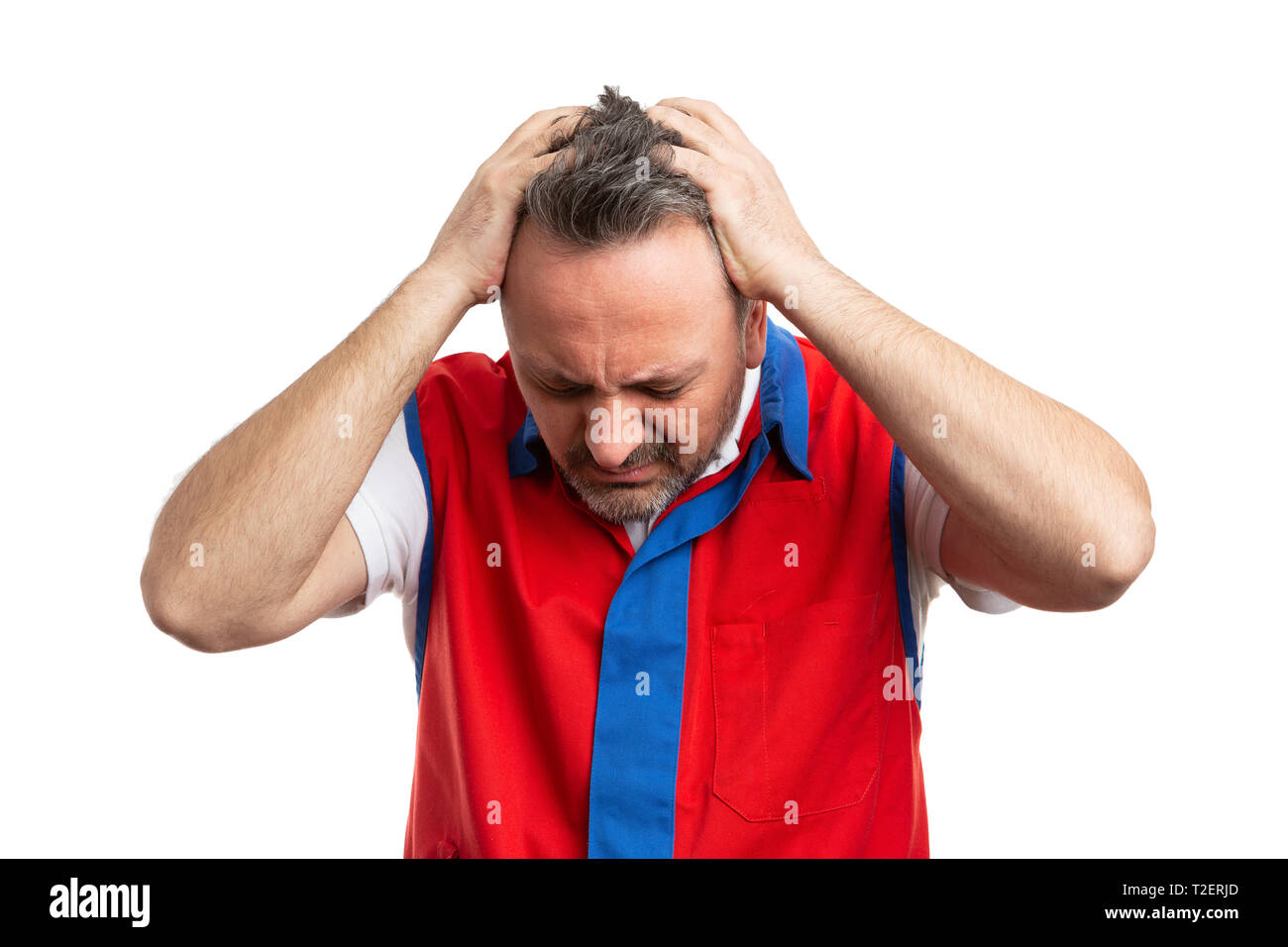 Hypermarket or supermarket male employee touching head with headache as stressed concept isolated on white studio background - Stock Image