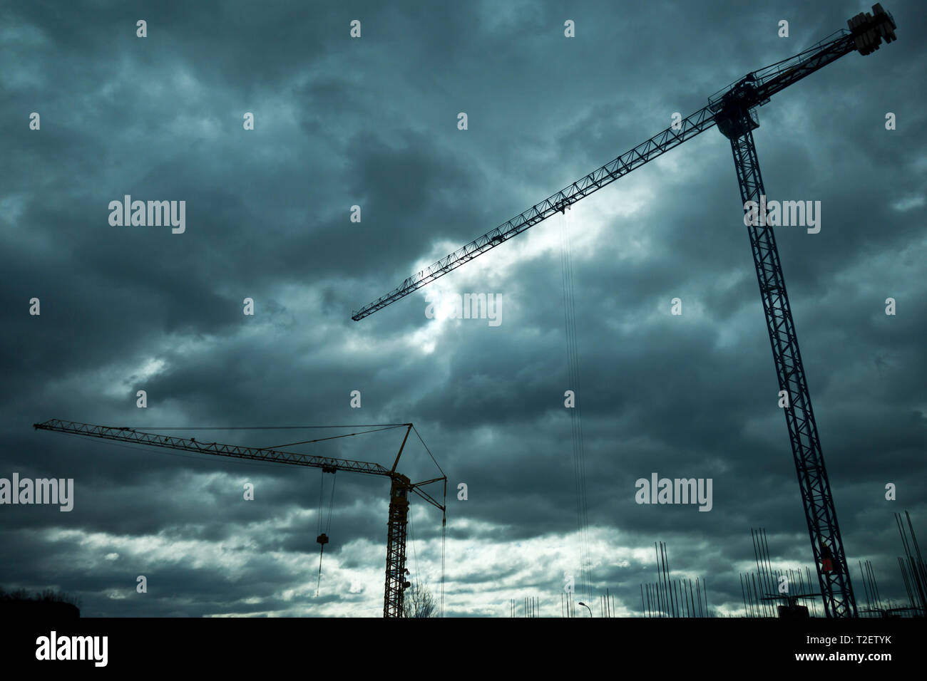 tower cranes at a construction site - Stock Image