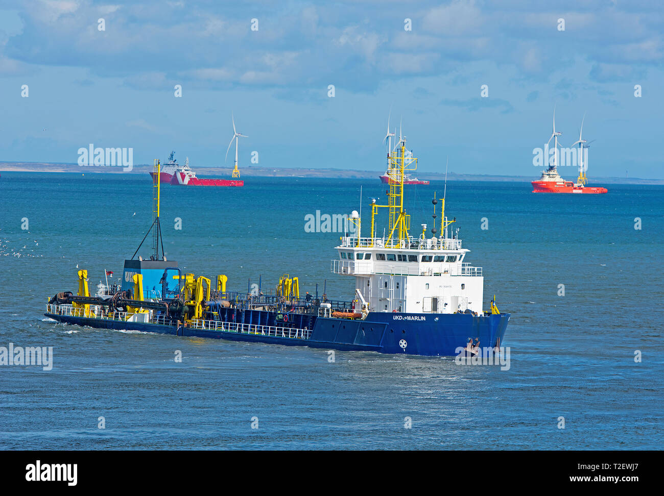 UKD Marlin .TRAILING SUCTION HOPPER DREDGER working in the Aberdeen harbour approach channel, in North East Scotland. - Stock Image