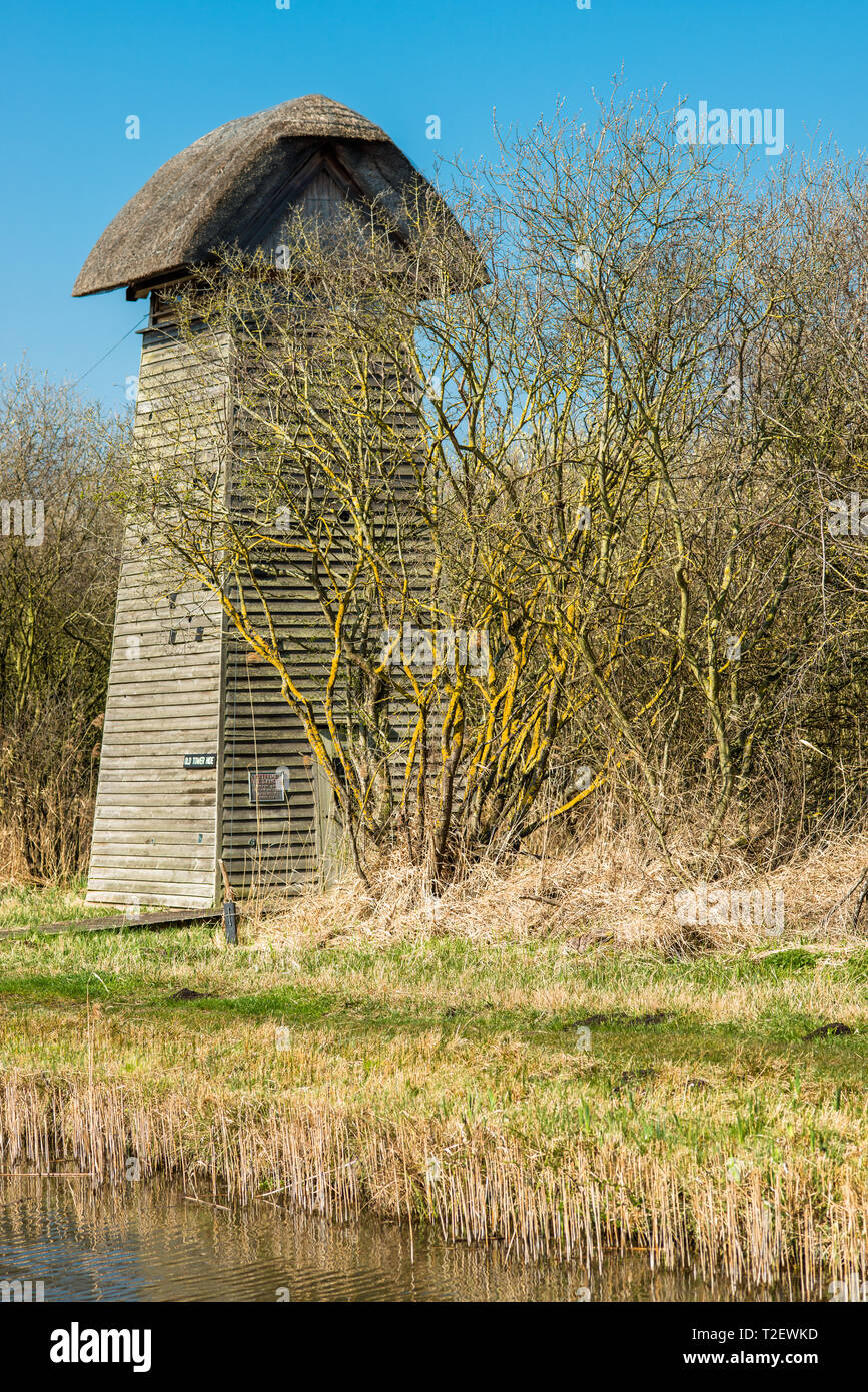 The Tower hide on the banks of Burwell Lode waterway on Wicken Fen nature reserve, Cambridgeshire; England; UK - Stock Image