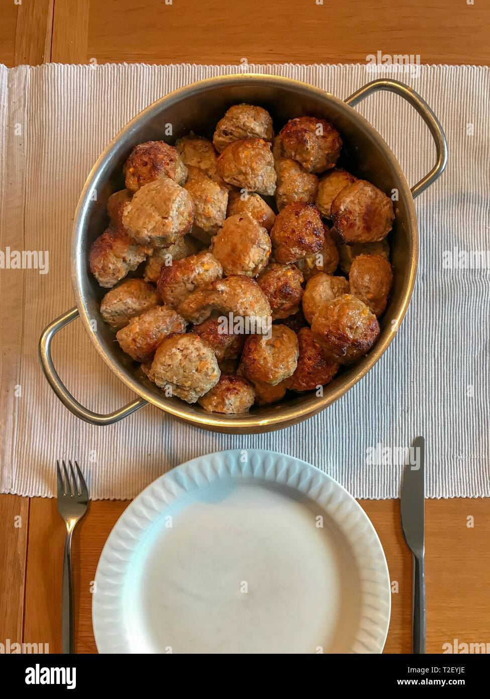 Meatballs, home cooking, laid table, Germany - Stock Image