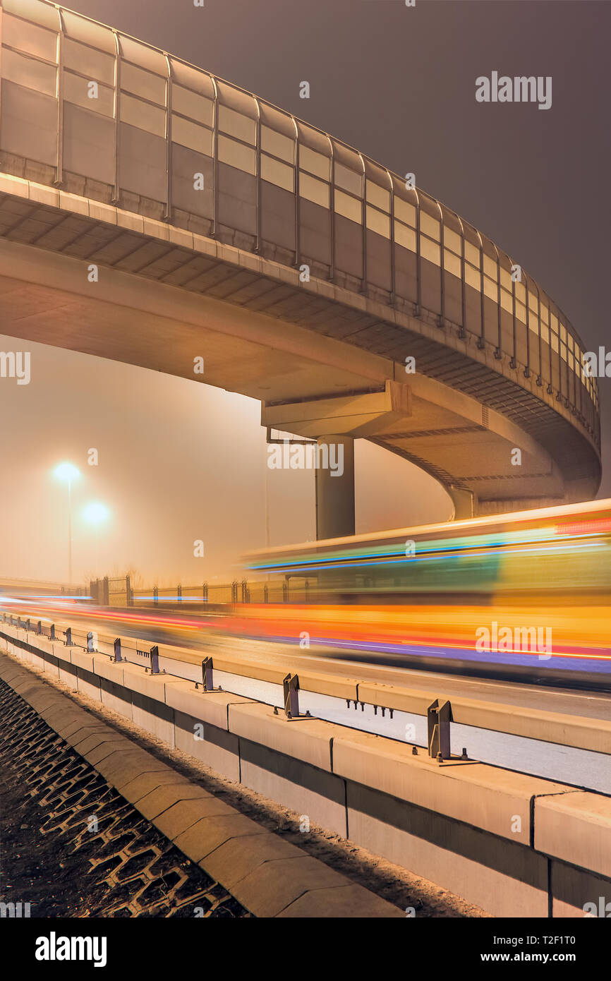 Urban night scene with motion blur and light trails, Beijing, China - Stock Image