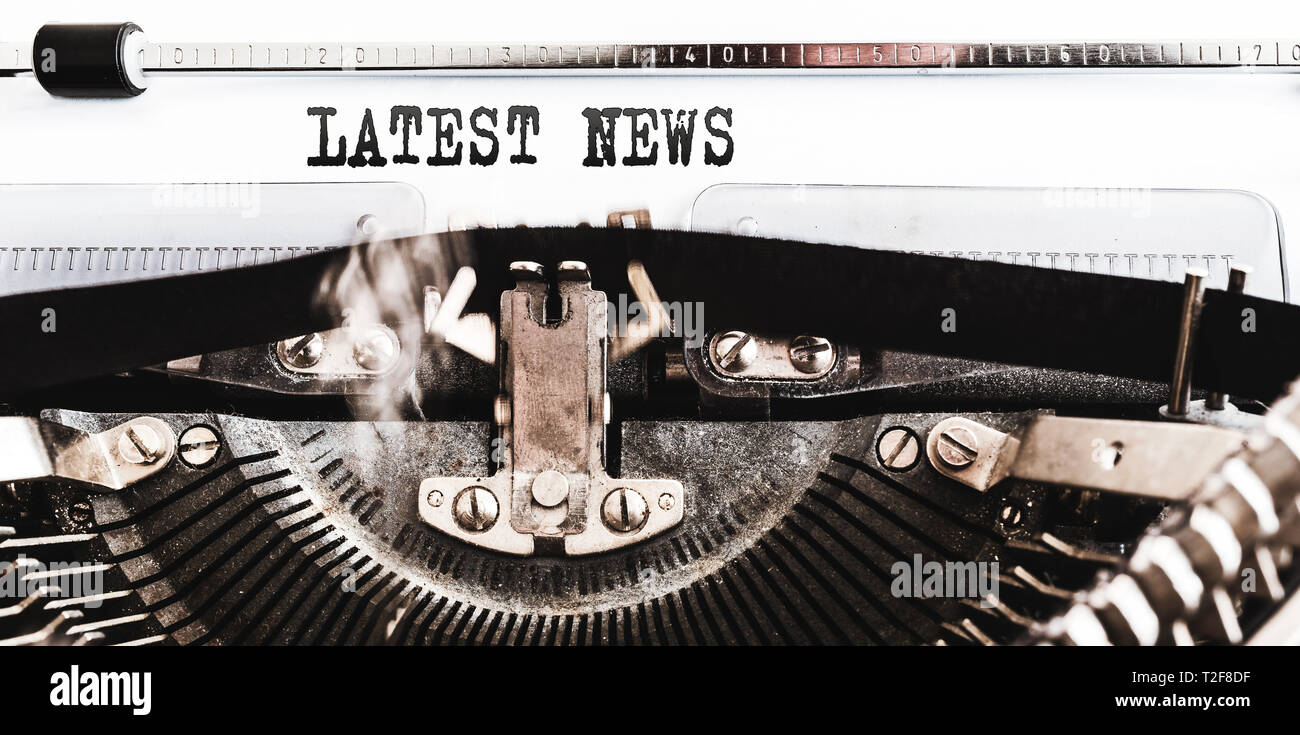 close-up of words LATEST NEWS written on old manual typewriter Stock Photo