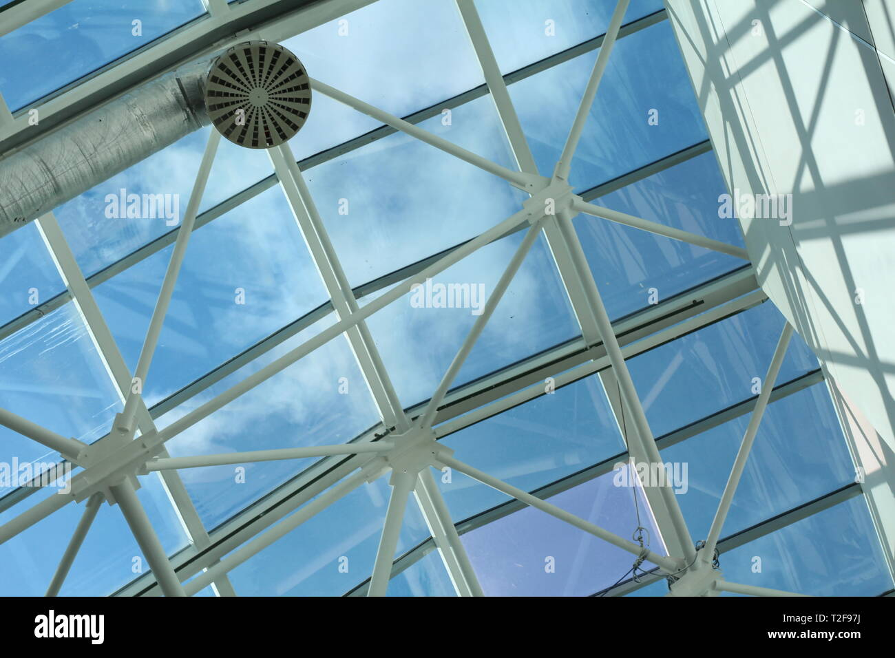Glass roof in the business center. Metal and glass construction - architecture and design in a shopping center. - Stock Image
