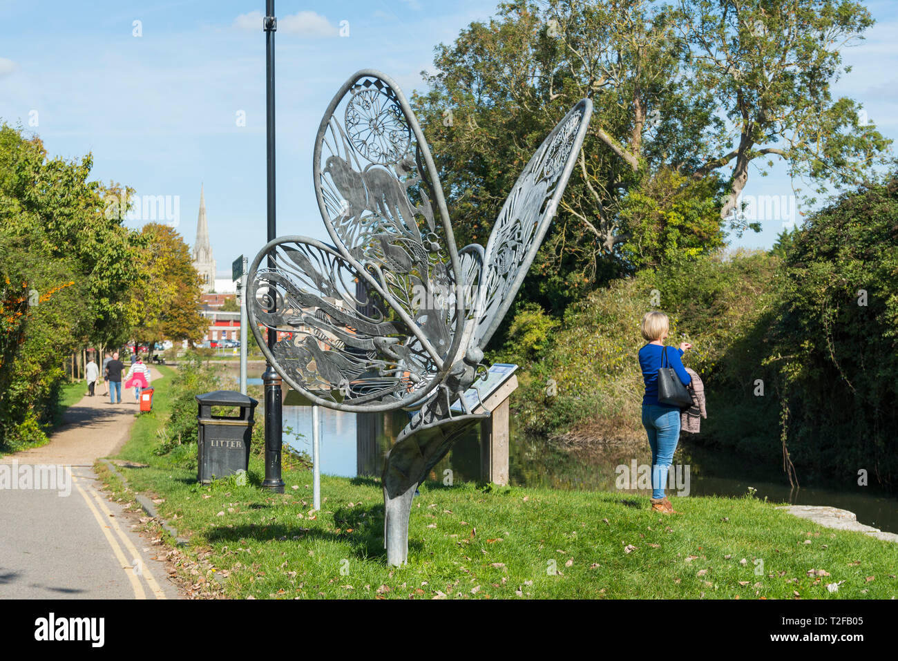 Butterfly sculpture on the towpath alongside Chichester Ship Canal, Chichester, West Sussex, England, UK. - Stock Image