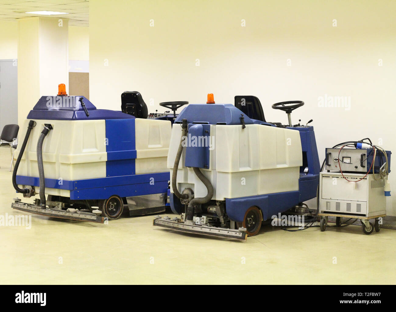 Machines for cleaning large spaces. Professional floor cleaning machines. High-performance autonomous self-propelled scrubber. - Stock Image