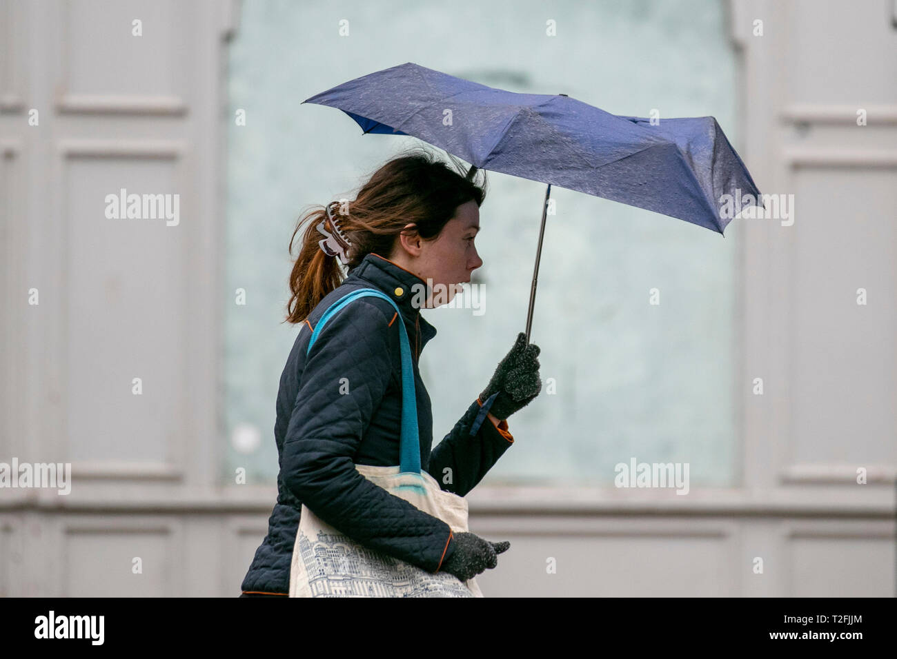 Preston, Lancashire. 2nd April, 2019. UK Weather. Rainy, cold, blustery start to the day in the city centre. Wet hair, rain, hail and wintery showers in the north-west a much colder spring day with widespread showers, some heavy. Credit. MWI/AlamyLiveNews - Stock Image