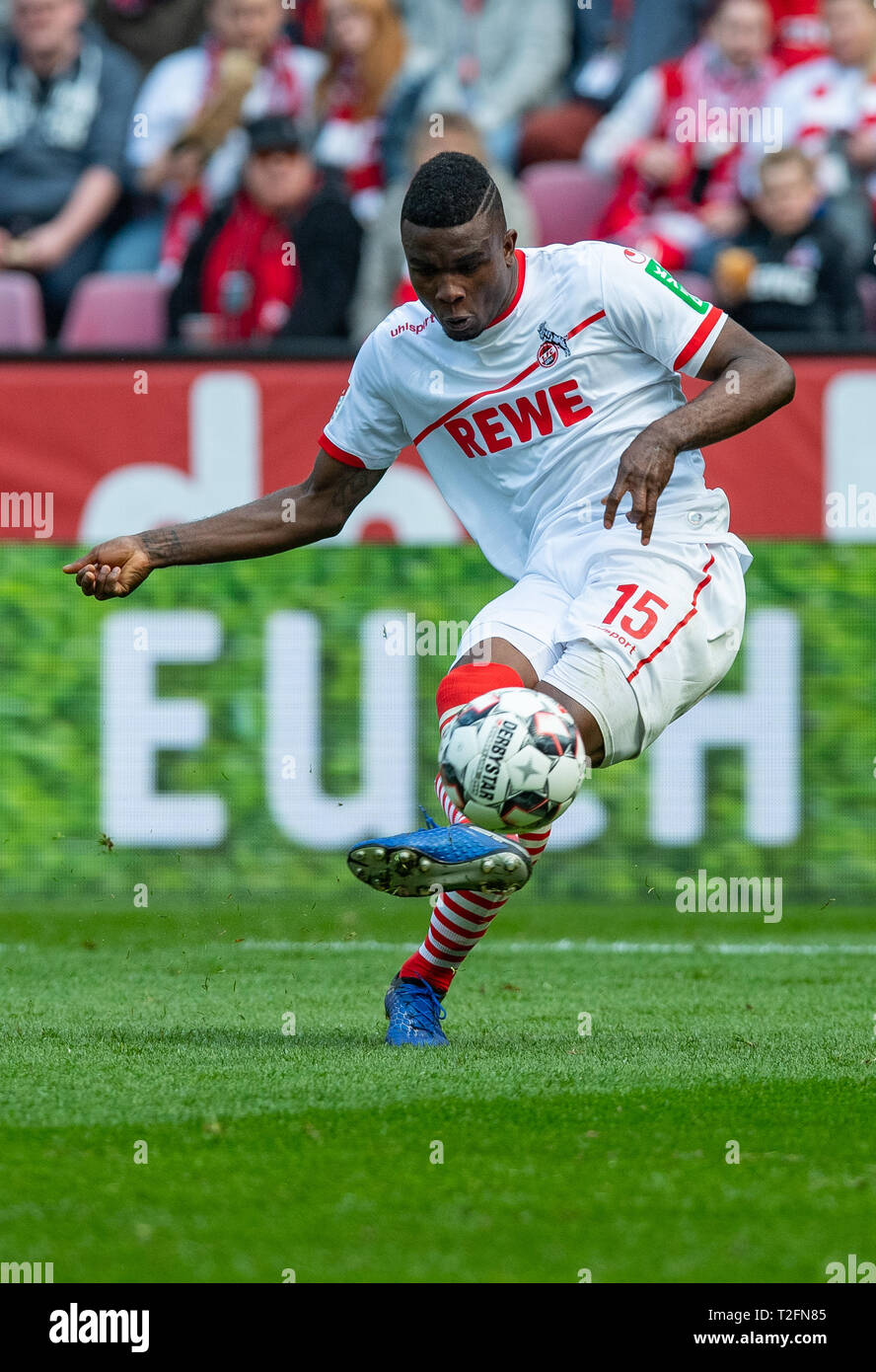 31 March 2019, North Rhine-Westphalia, Köln: Soccer: 2nd Bundesliga, 1st FC Cologne - Holstein Kiel, 27th matchday in the Rhein-Energie-Stadion. Cologne's Jhon Cordoba shoots the ball at the goal. Photo: Guido Kirchner/dpa - IMPORTANT NOTE: In accordance with the requirements of the DFL Deutsche Fußball Liga or the DFB Deutscher Fußball-Bund, it is prohibited to use or have used photographs taken in the stadium and/or the match in the form of sequence images and/or video-like photo sequences. Stock Photo