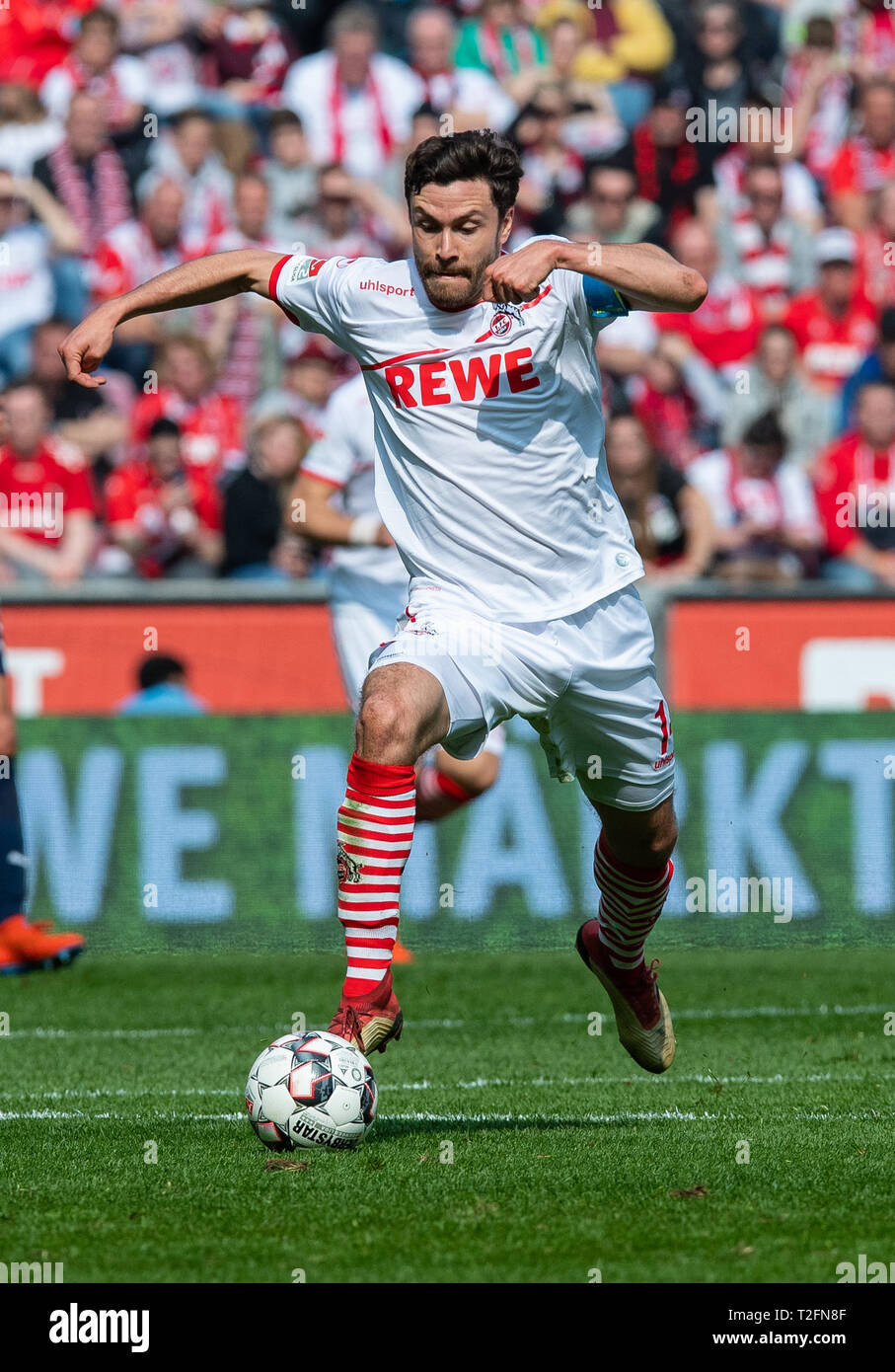31 March 2019, North Rhine-Westphalia, Köln: Soccer: 2nd Bundesliga, 1st FC Cologne - Holstein Kiel, 27th matchday in the Rhein-Energie-Stadion. Cologne's Jonas Hector on the ball. Photo: Guido Kirchner/dpa - IMPORTANT NOTE: In accordance with the requirements of the DFL Deutsche Fußball Liga or the DFB Deutscher Fußball-Bund, it is prohibited to use or have used photographs taken in the stadium and/or the match in the form of sequence images and/or video-like photo sequences. Stock Photo