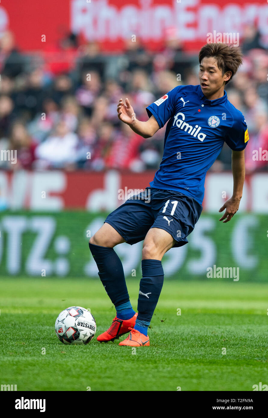31 March 2019, North Rhine-Westphalia, Köln: Soccer: 2nd Bundesliga, 1st FC Cologne - Holstein Kiel, 27th matchday in the Rhein-Energie-Stadion. Kiels Masaya Okugawa on the ball. Photo: Guido Kirchner/dpa - IMPORTANT NOTE: In accordance with the requirements of the DFL Deutsche Fußball Liga or the DFB Deutscher Fußball-Bund, it is prohibited to use or have used photographs taken in the stadium and/or the match in the form of sequence images and/or video-like photo sequences. Stock Photo