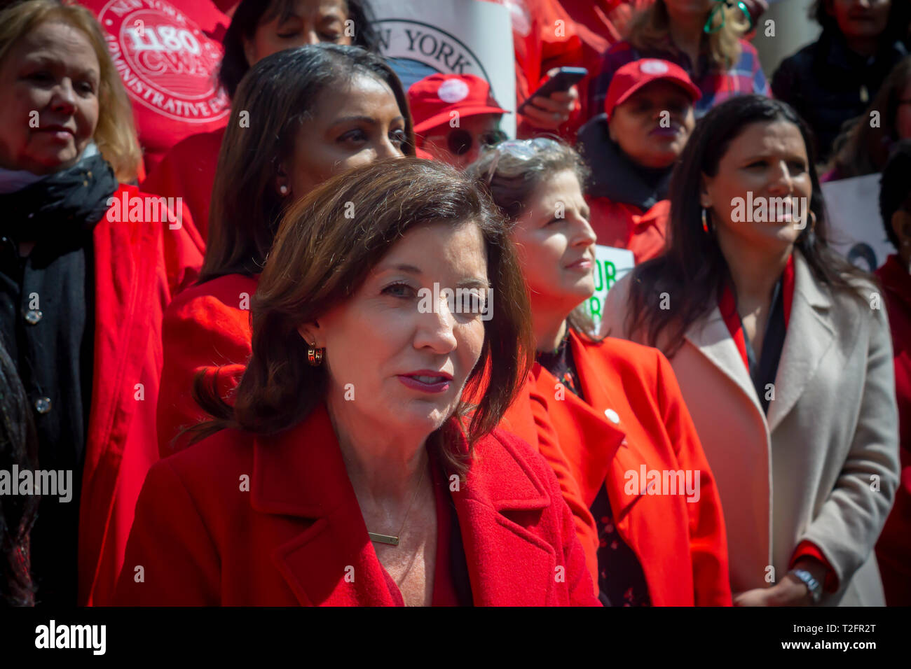 New York, USA. 02nd Apr, 2019. NYS Lt. Governor Kathy Hochul joins activists, community leaders, union members and other politicians on the steps of City Hall in New York on Tuesday, April 2, 2019 to rally against pay disparity on the 13th annual Equal Pay Day. Worldwide women on average earn 87 cents for every dollar her male counterpart earns with dramatic adjustments for women of color. Credit: Richard Levine/Alamy Live News - Stock Image