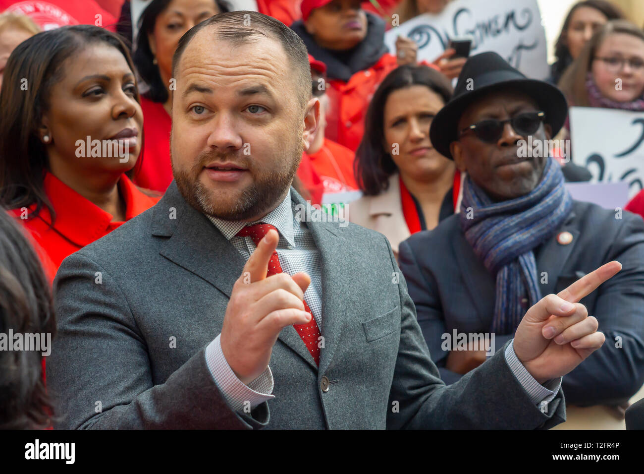 New York, USA. 02nd Apr, 2019. NYC Council Speaker Corey Johnson joins activists, community leaders, union members and other politicians on the steps of City Hall in New York on Tuesday, April 2, 2019 to rally against pay disparity on the 13th annual Equal Pay Day. Worldwide women on average earn 87 cents for every dollar her male counterpart earns with dramatic adjustments for women of color. Credit: Richard Levine/Alamy Live News - Stock Image