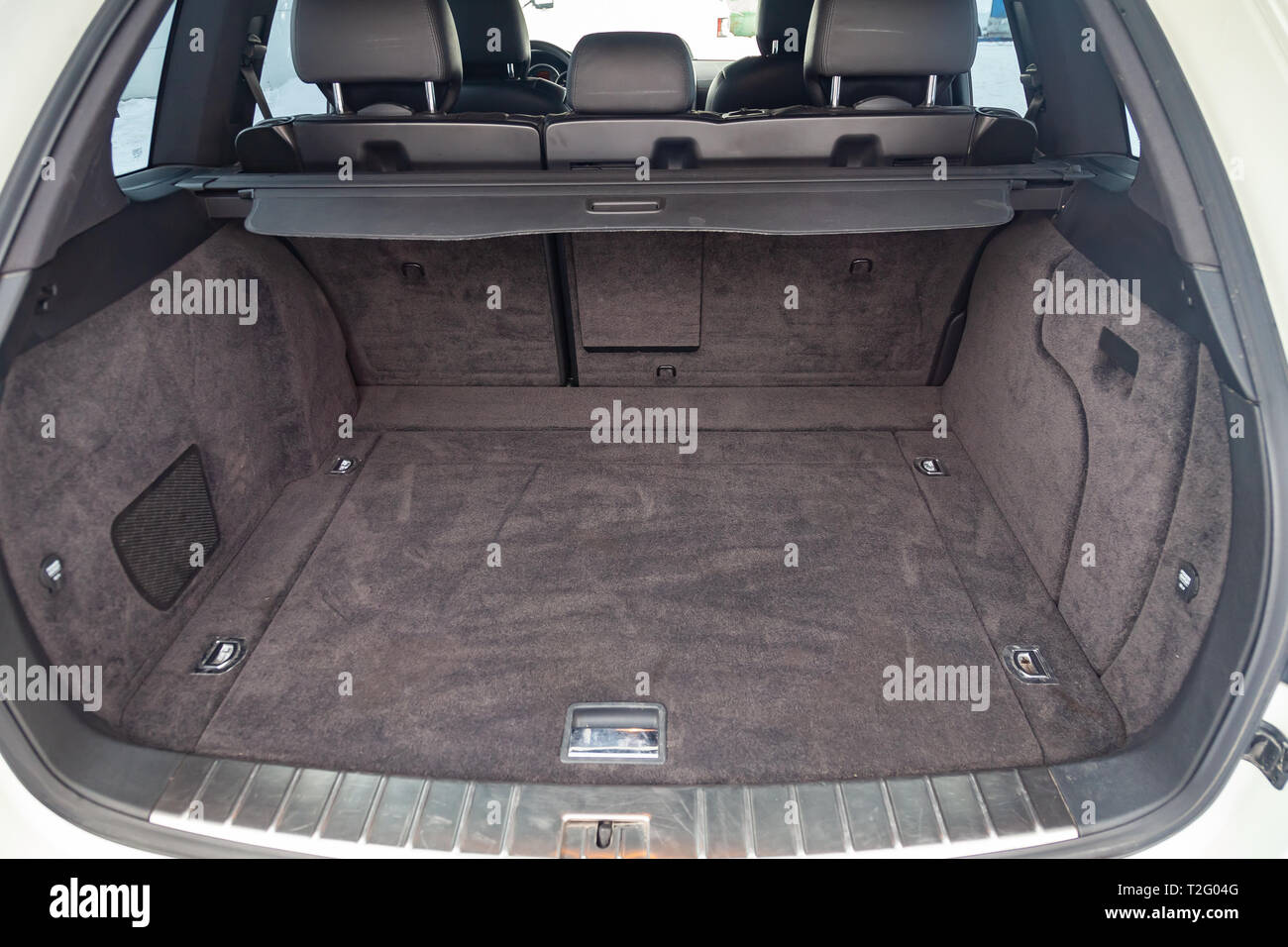 Novosibirsk, Russia - 03.10.2019: View to the interior of Porsche Cayenne 957 2007 with opened bagпage trunk after cleaning before sale on parking - Stock Image