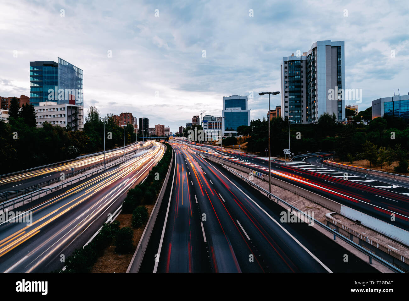 M30 motorway in Madrid at sunset. Long exposure with traffic light trails Stock Photo