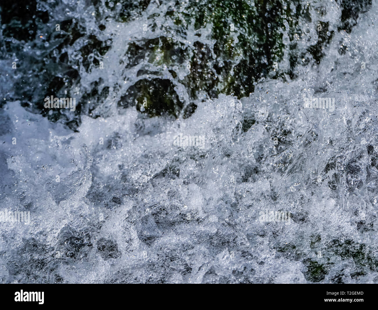 Close up waterfall of pure water in the mountains. - Stock Image