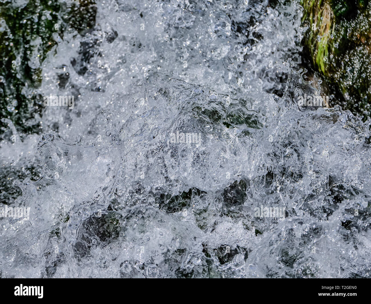 Close up mountain waterfall with clean fresh water. - Stock Image