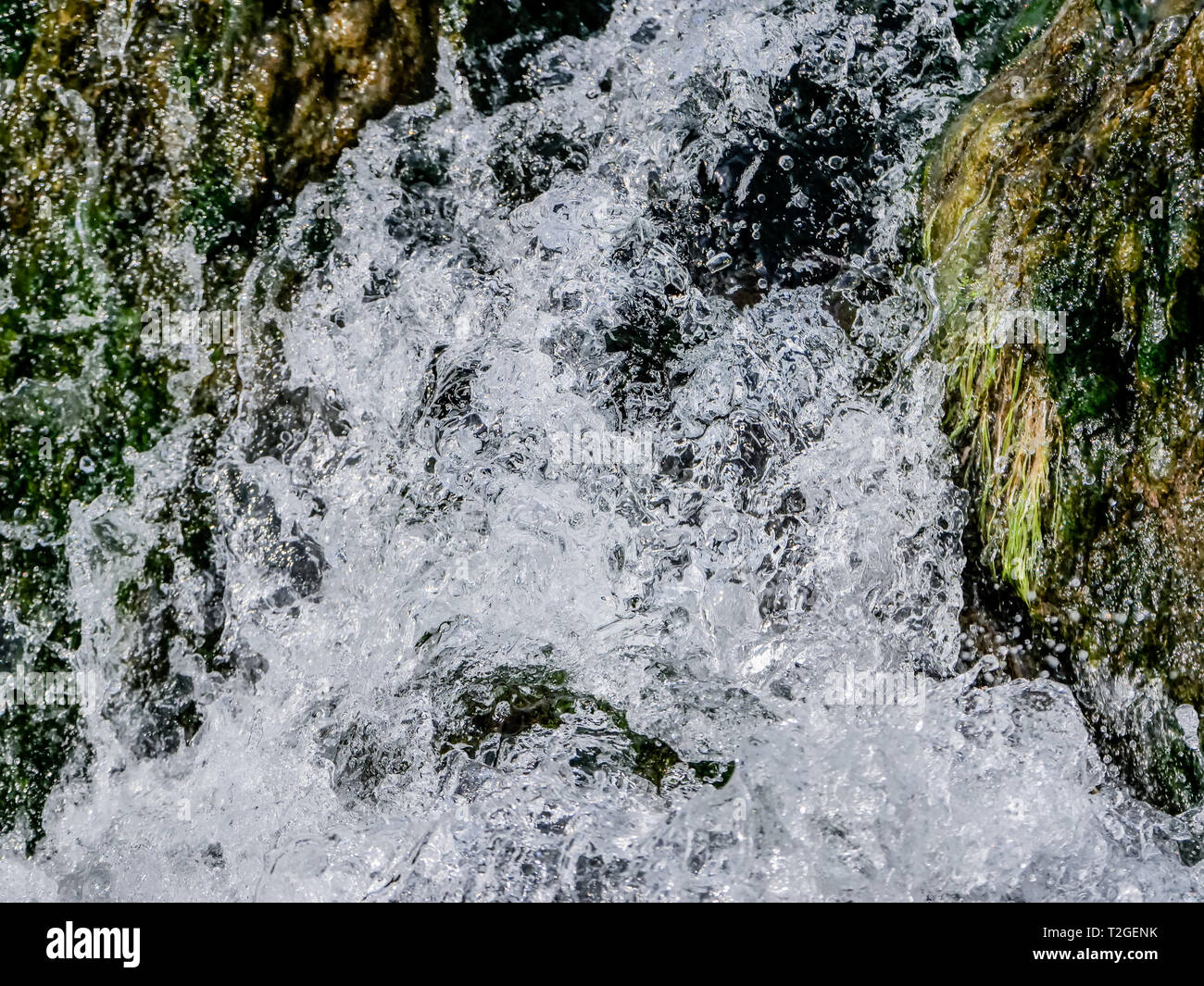 Mountain waterfall with clean and fresh water. - Stock Image