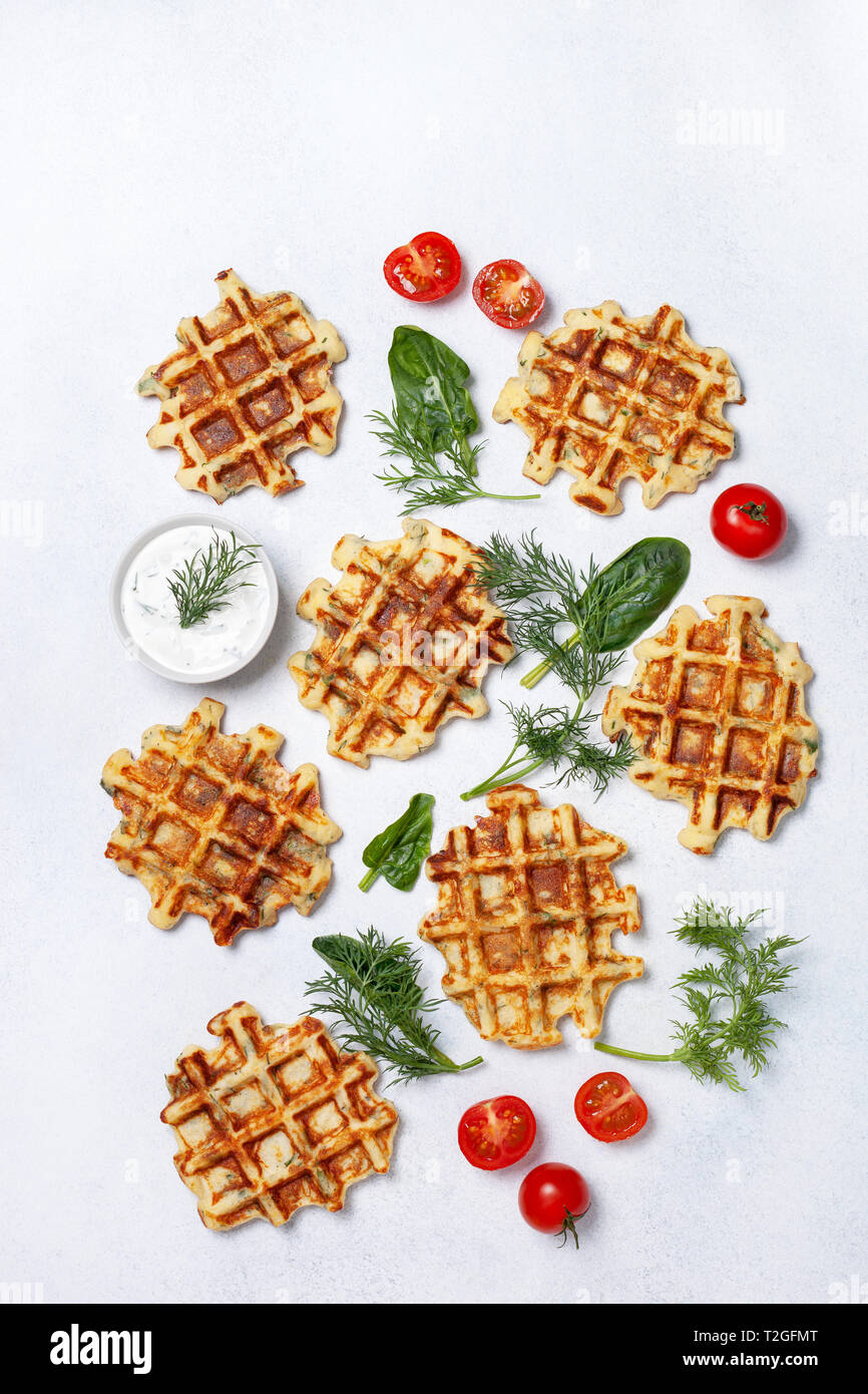 healthy breakfast. savory  spinach dill waffles, with tzatziki on a white background. view from above - Stock Image