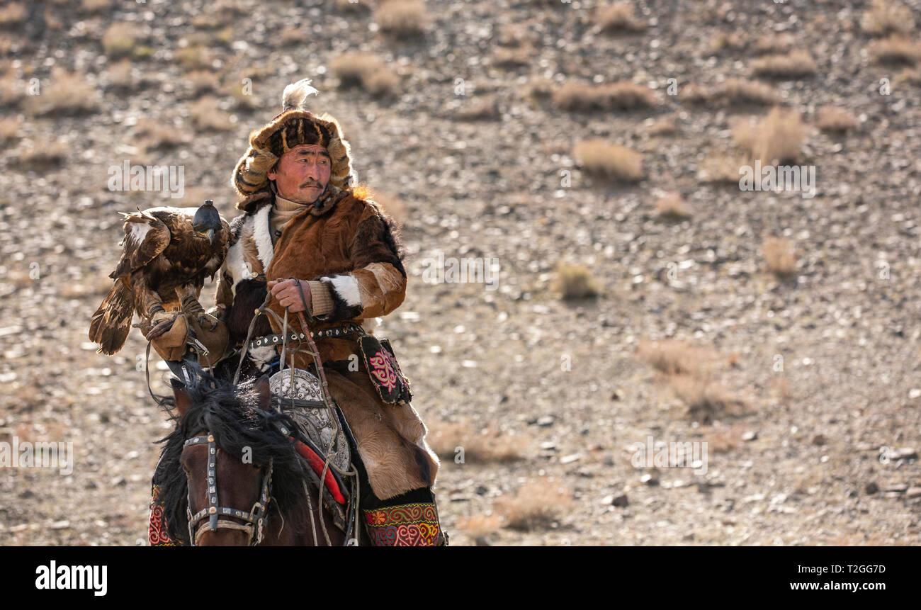 bayan Ulgii, Mongolia, 4th October 2015: kazakh eagle hunter on his horse Stock Photo