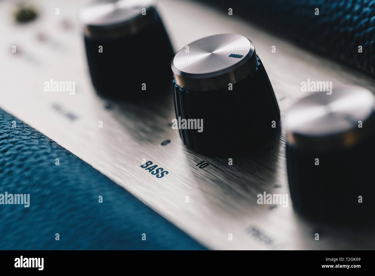 Bass control knob on music amplifier equalizer Stock Photo