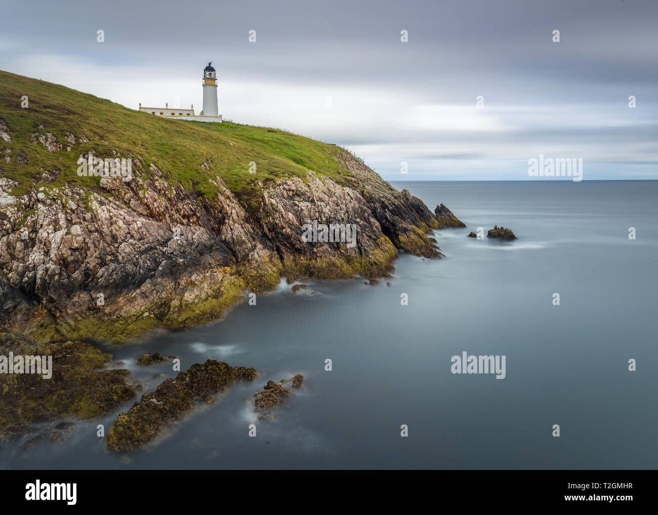 A long exposure of Tiumpan Head Lighthouse on a cloudy day, Isle of Harris, Outer Hebrides, Scotland, UK - Stock Image