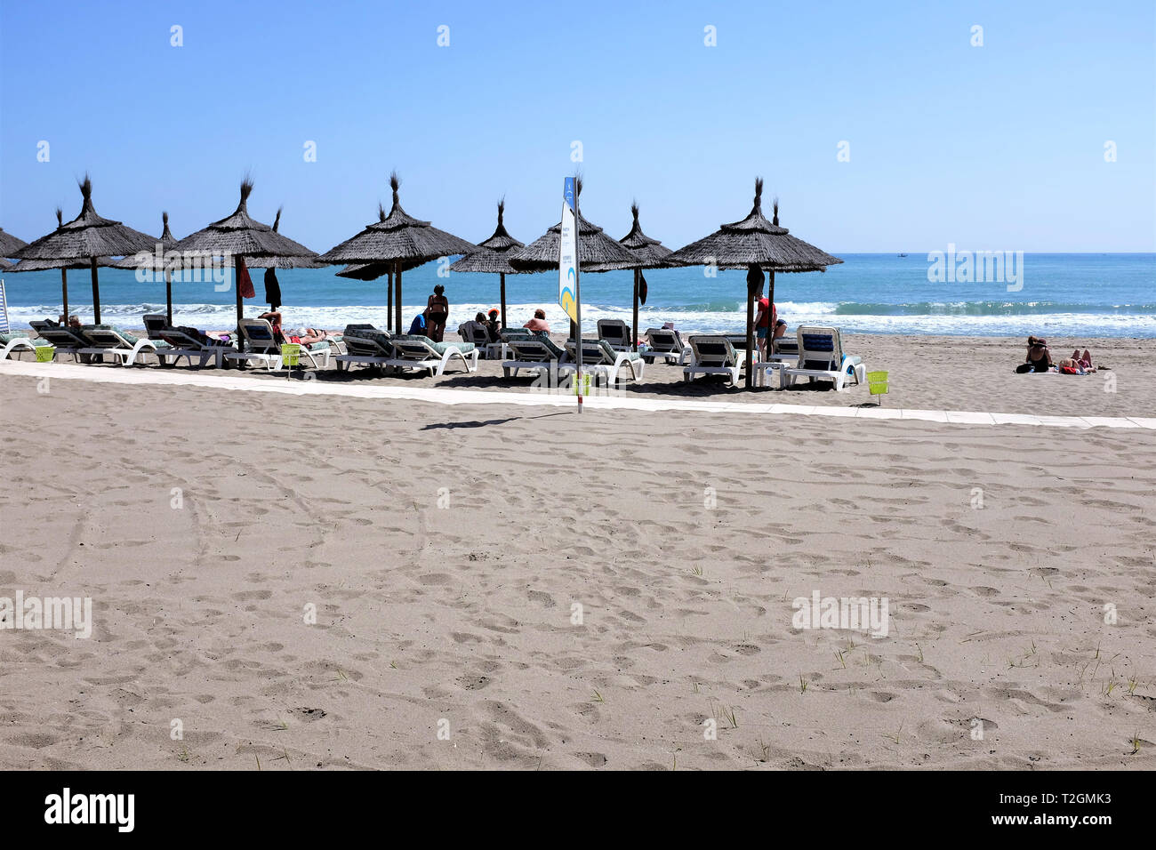 Fuengirola, Costa del Sol, Spain.  March 25, 2019. Holidaymakers enjoying the sunshine on a Mediterranean beach at Fuengerola on the Costa del Sol. - Stock Image