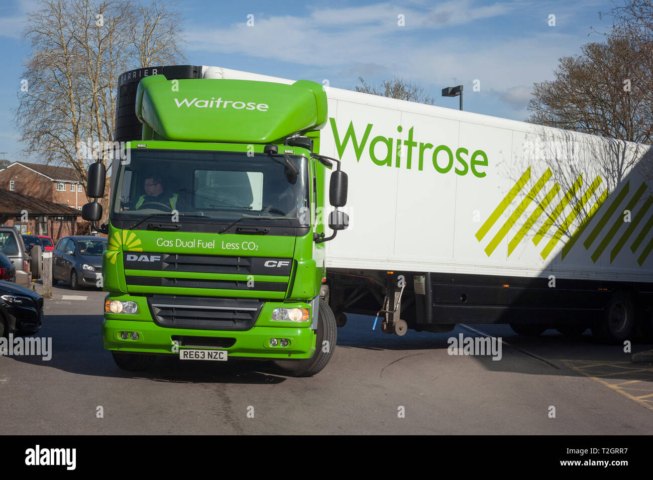 An energy efficient Gas Dual Fuel Waitrose lorry makes a delivery at the Henley-on-Thames branch with the slogan 'Less CO2' - Stock Image