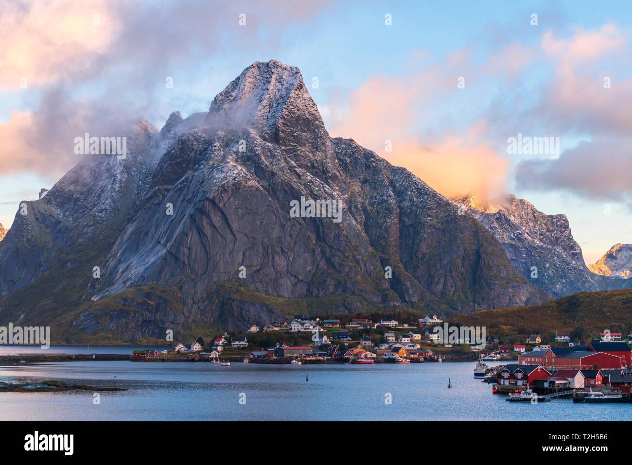 Olstinden mountain above town at sunset in Reine, Moskenes, Norway, Europe Stock Photo