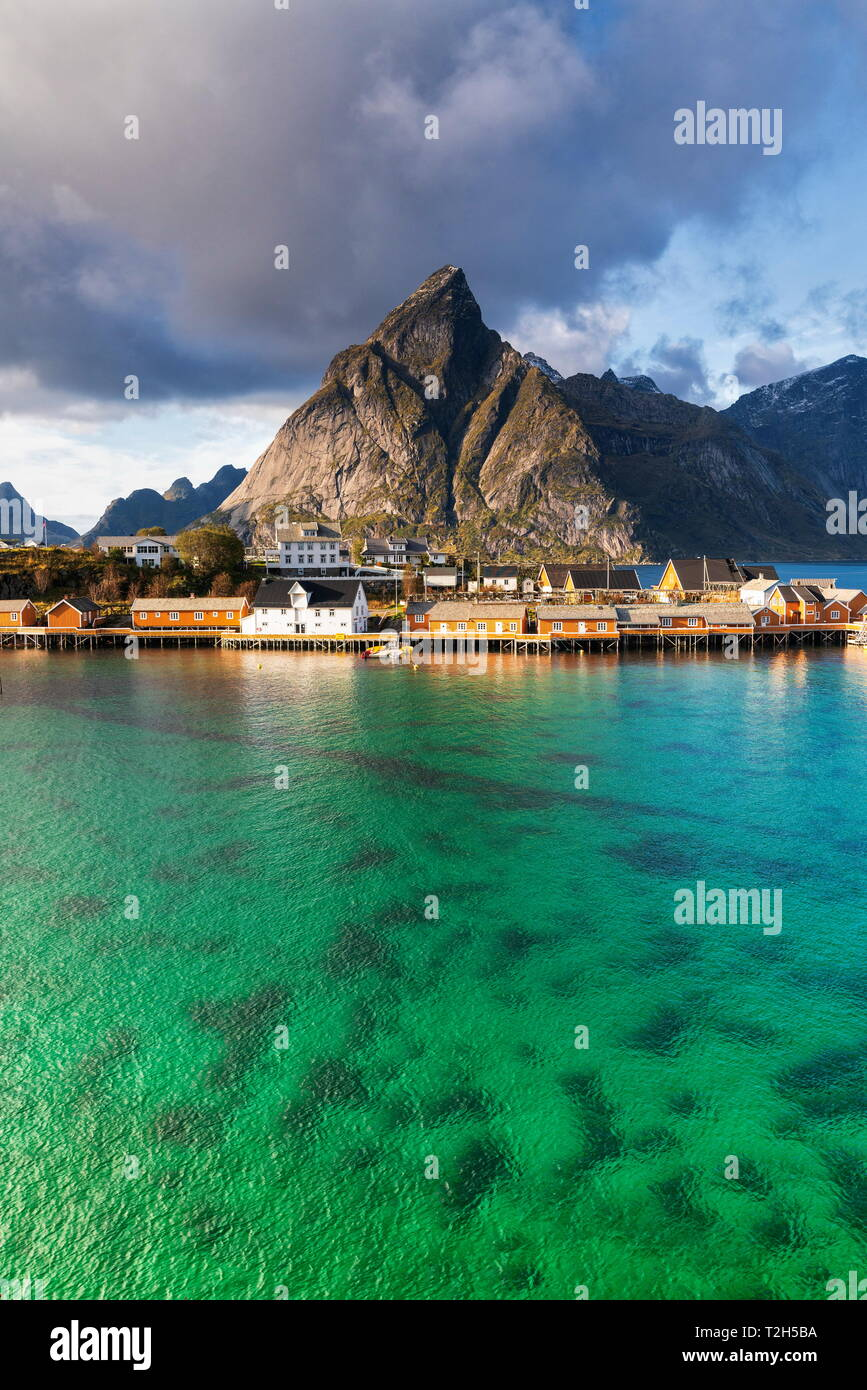 Town of Sakrisoy under Olstinden mountain in Reine, Norway, Europe Stock Photo