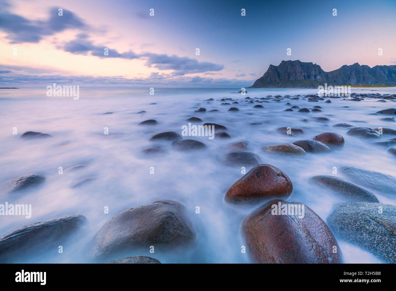 Long exposure shot of rocks on Uttakleiv beach in Vestvagoy, Norway, Europe - Stock Image