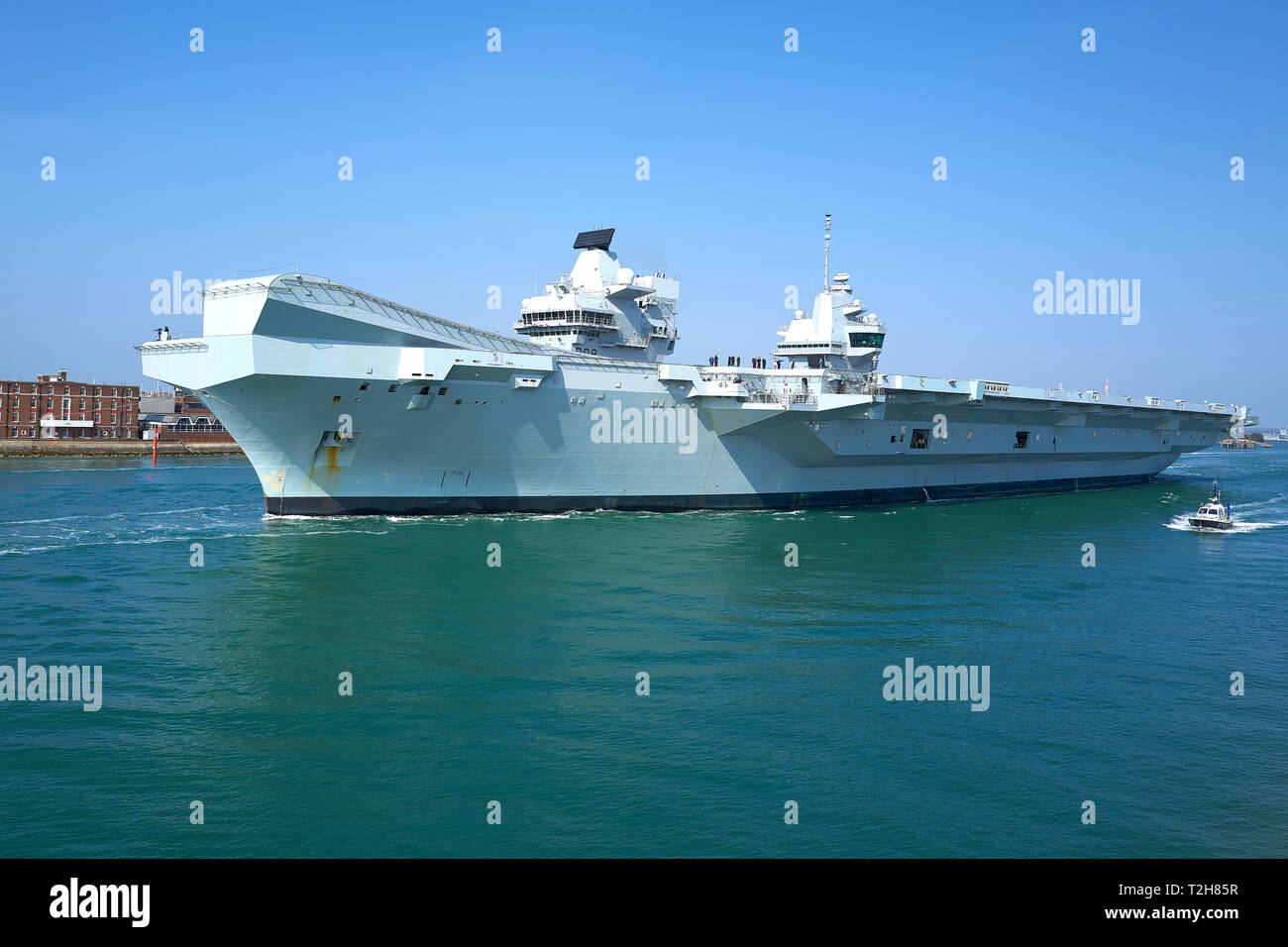 The Royal Navy Aircraft Carrier, HMS QUEEN ELIZABETH, Leaves Portsmouth Harbour For Rosyth, Scotland. 01 April 2019. - Stock Image