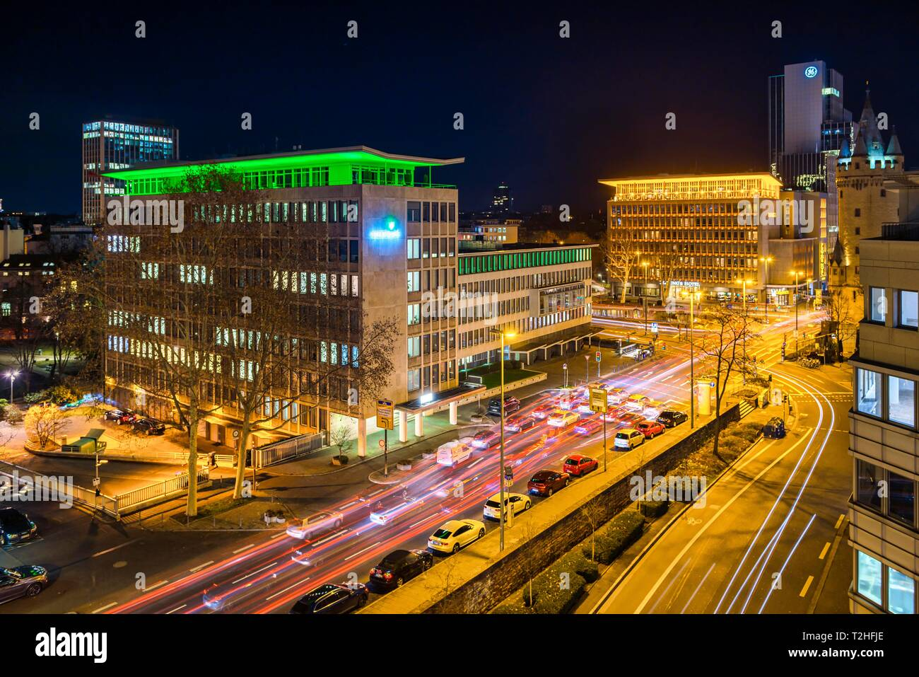 Illuminated intersection at Eschenheimer Turm with view of Rentenbank and Fleming's Deluxe Hotel Frankfurt-City, downtown, Frankfurt am Main, Hesse - Stock Image