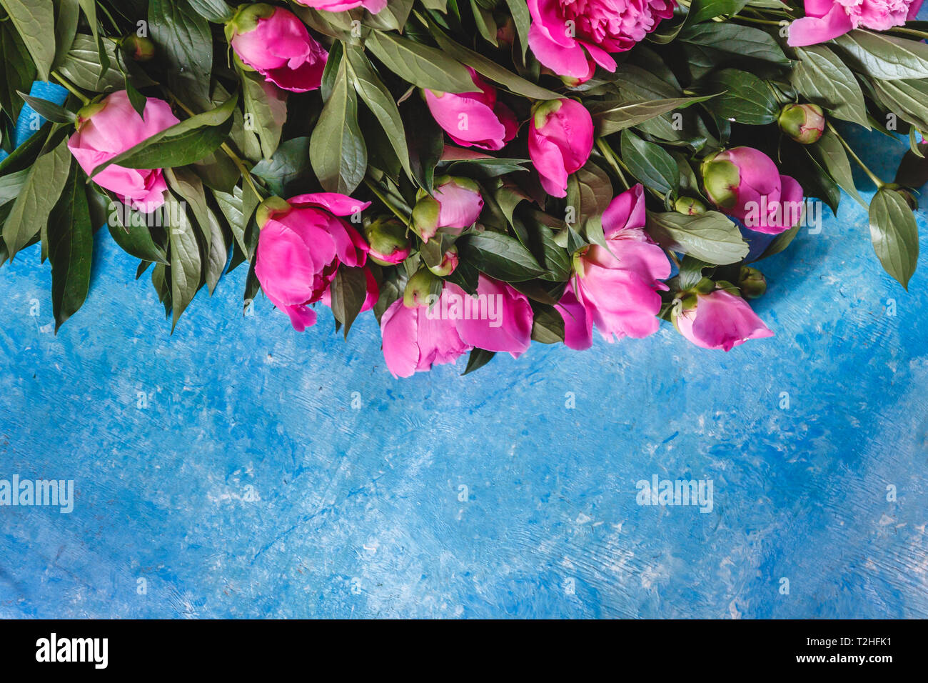 Bouquet Of Pink Purple Peonies In A Vase On A Blue Marble Concrete Background View From Above Flat Lay Stock Photo Alamy