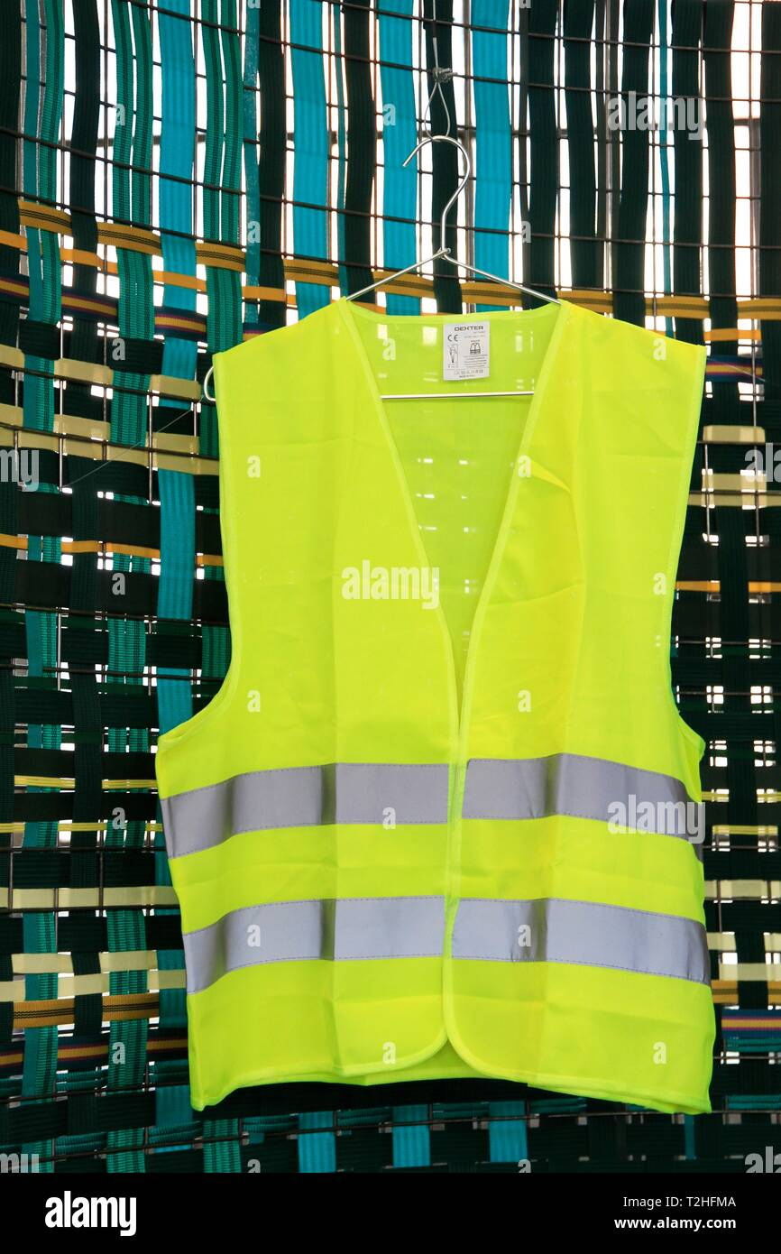 Yellow vest exhibited at the biennale of design. Saint Etienne, Loire, Auvergne Rhone Alpes. Saint-Etienne, FRANCE - 04/01/2019     Gilet jaune expose Stock Photo