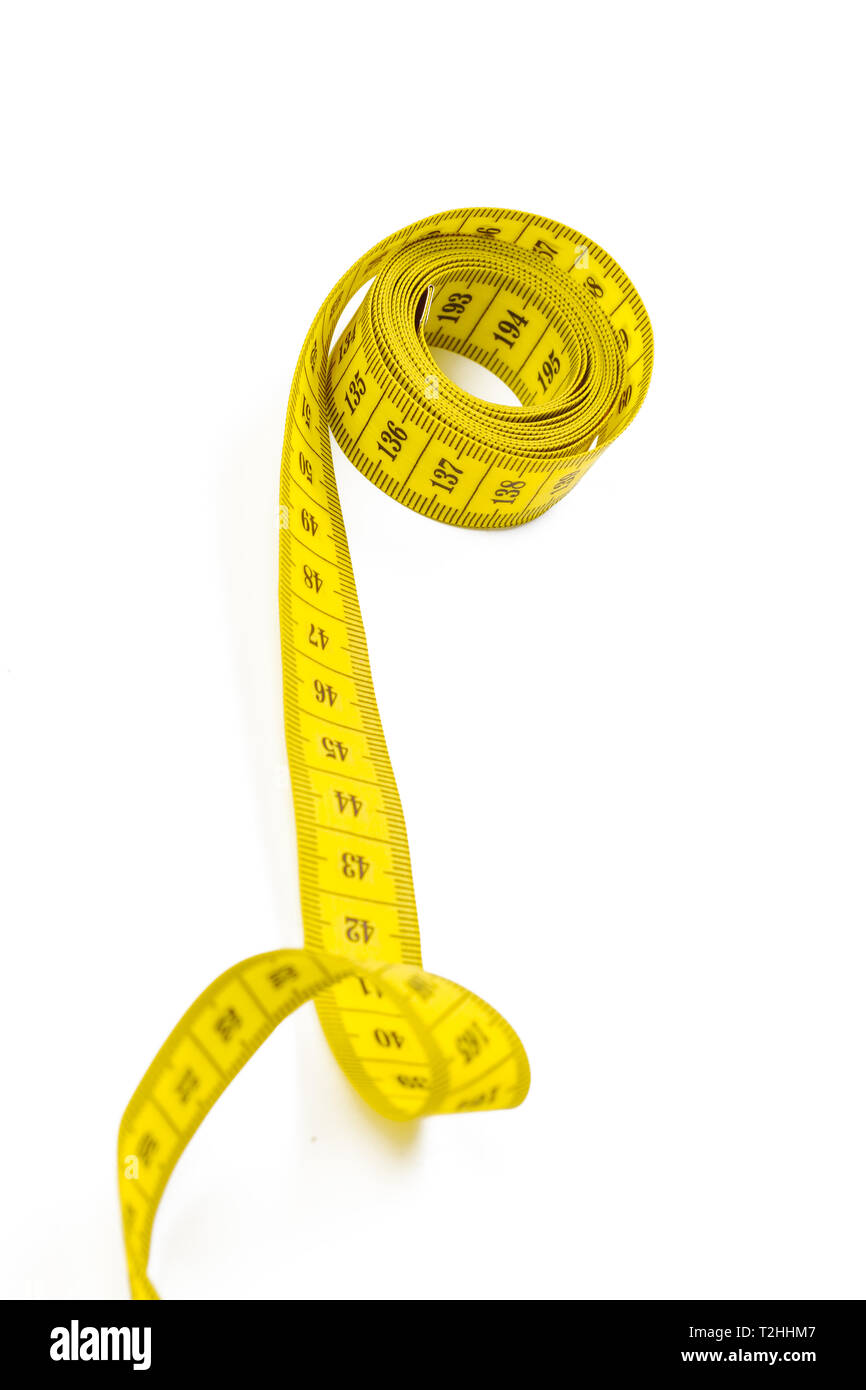 yellow metric measuring tape isolated on white panorama background - Stock Image