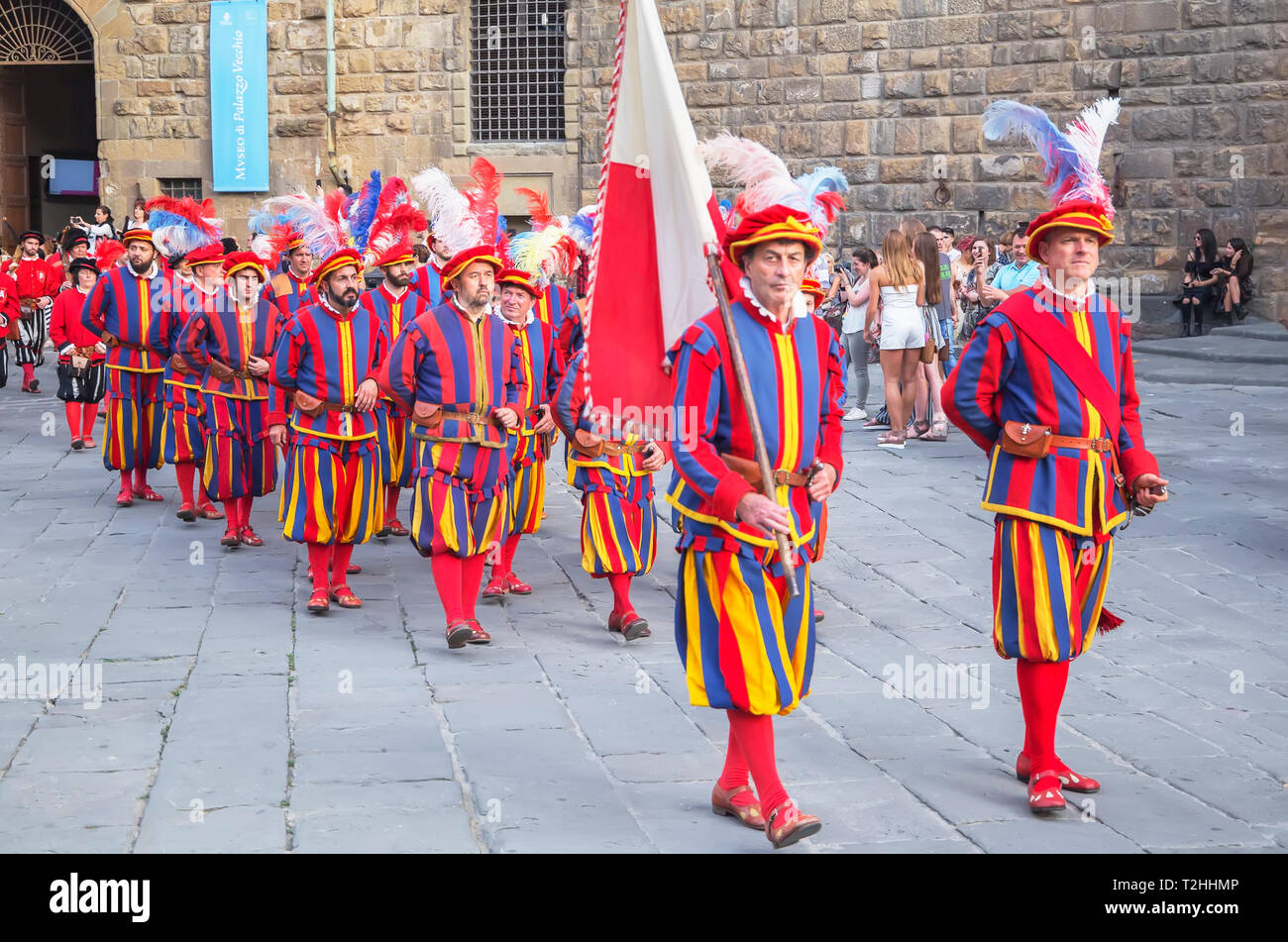 Men marching in costume during Calcio Storico Fiorentino festival at Piazza della Signoria in Florence, Tuscany, Italy, Europe Stock Photo