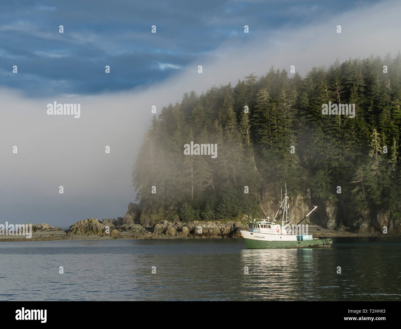 The fishing boat Steller anchored in the fog at George Island, Cross Sound, Southeast Alaska, United States of America - Stock Image