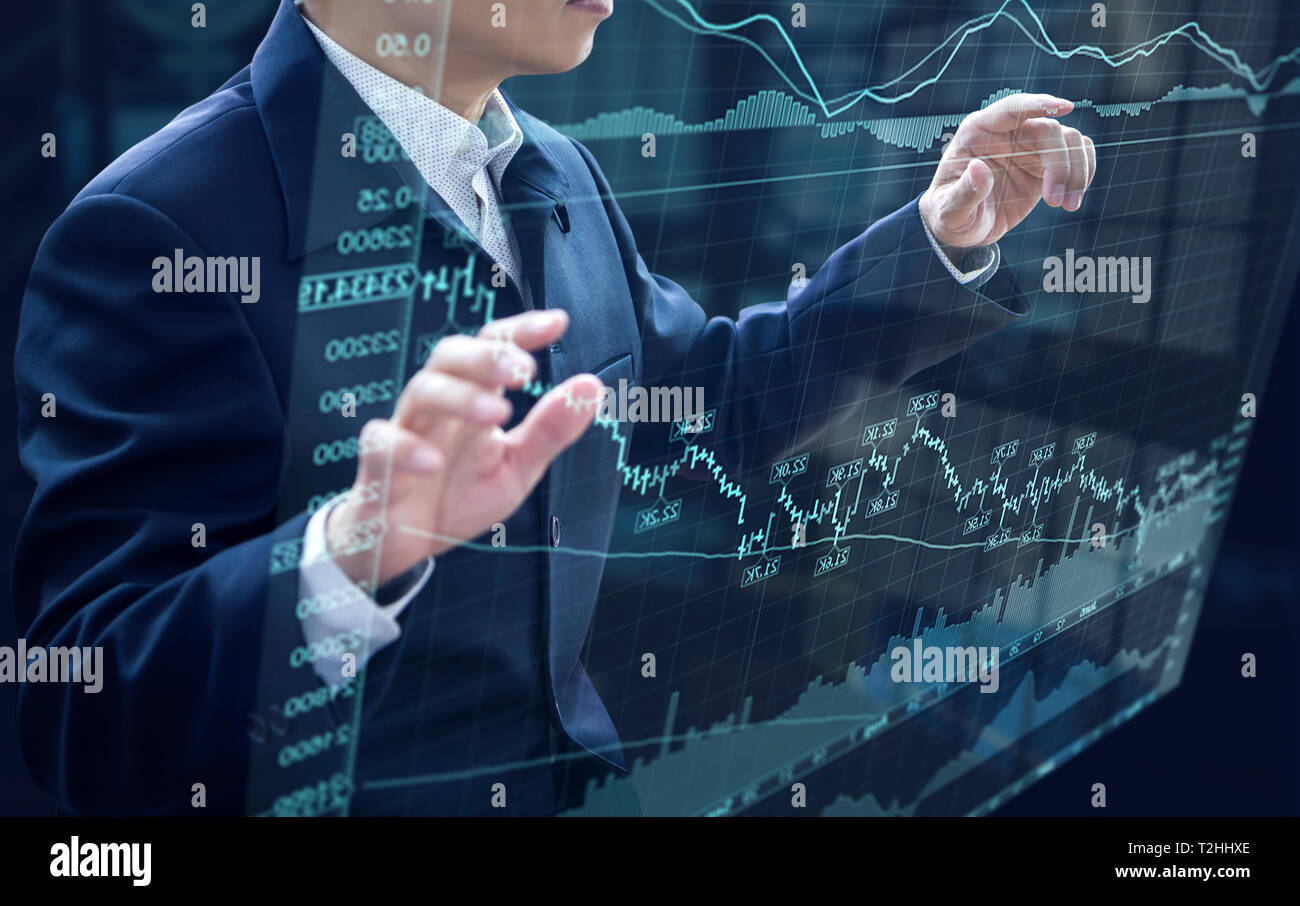 Businessman in front of virtual modern computer virtual touch screen analysing on investment risk management and return on investment analysis Stock Photo