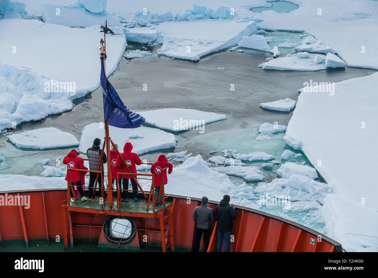 Tourists watching the ice breaking on board of an icebreaker, North Pole, Arctic Stock Photo