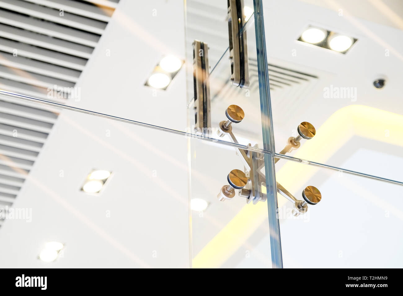 Glass facades and walls. Metal fasteners. Selective focus - Stock Image