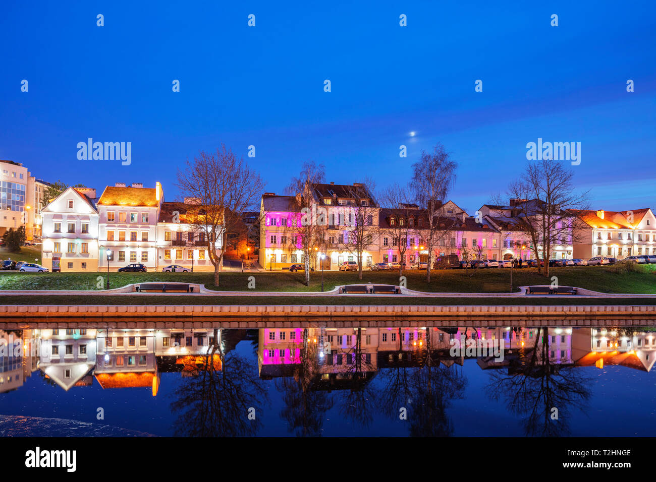 Trinity Suburb reflecting in the Svislach river, Minsk, Belarus, Eastern Europe - Stock Image