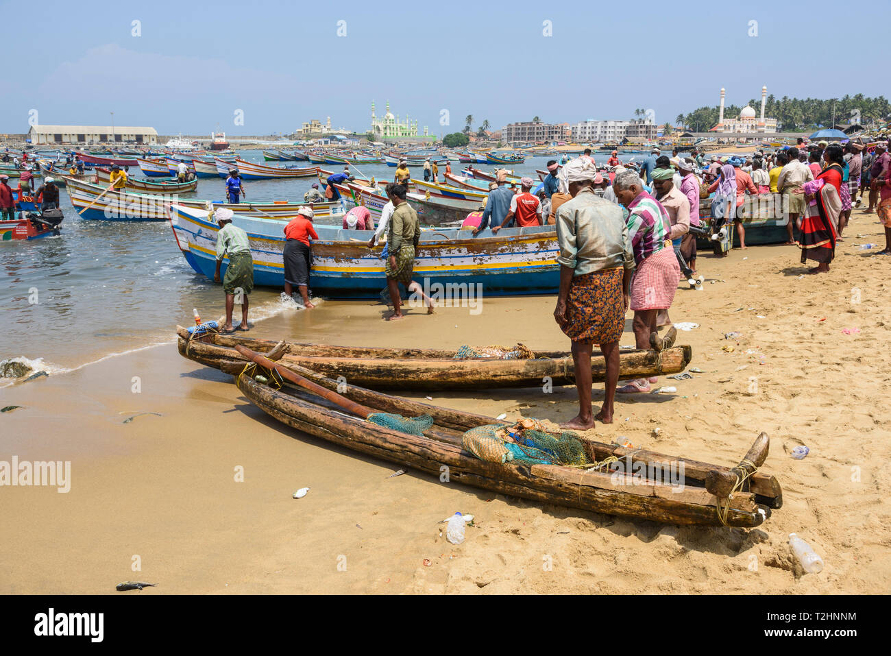 Fishing boats at Vizhinjam beach fish market, near Kovalam, Kerala, India, South Asia - Stock Image