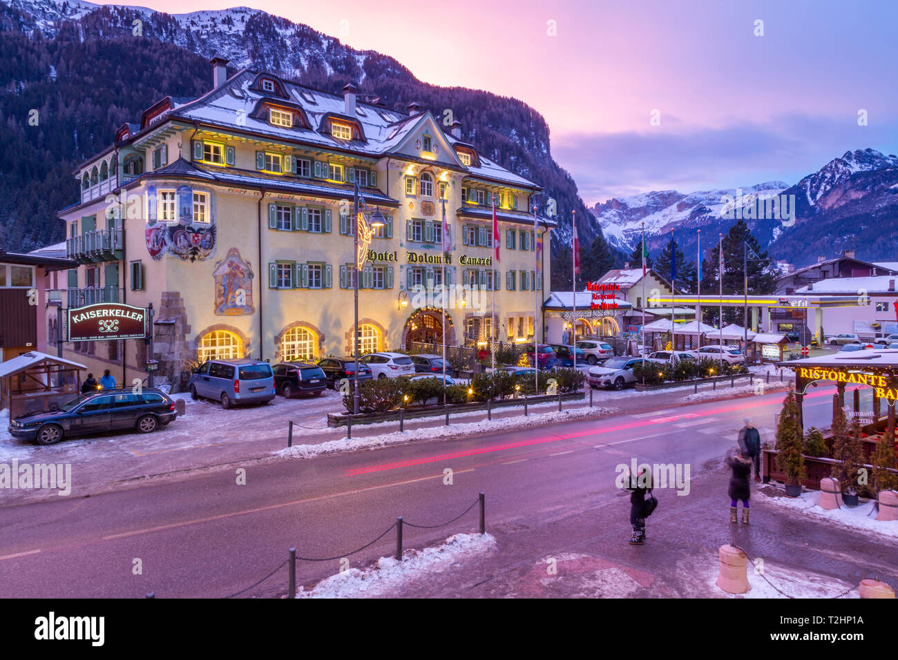 View of Hotel Dolomiti Canazei at dusk in winter, Canazei, Val di Fassa, Trentino, Italy, Europe - Stock Image