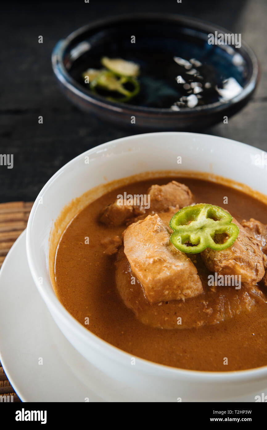 Bowl of traditional Ghanaian dish of fish soup and homemade Fufu, Busua, Ghana, Africa - Stock Image