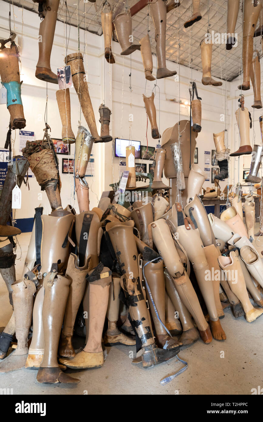 Artificial limbs for victims of bombs and landmines inside the COPE visitor centre, Boulevard Khou Vieng, Vientiane, Laos, Southeast Asia - Stock Image